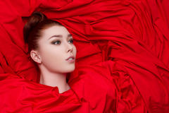 Beautiful glamorous girl in red cloth Stock Photos
