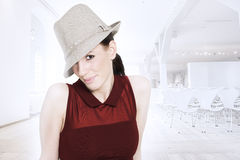 Beautiful trendy woman with hat royalty free stock photography