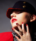 Beautiful glamorous young woman in stylish cap Royalty Free Stock Photo