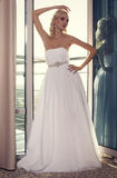 Beautiful glamour bride with blond hair in elegant dress Stock Image