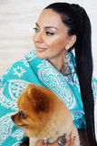 Beautiful glamour elegant brunette female model with a small dog. Portrait of beautiful glamour elegant brunette female model with a small dog Royalty Free Stock Photos