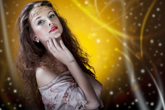 Beautiful glamour girl on artistic background Stock Photos
