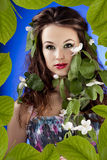Beautiful glamour girl in leafs frame with flowers in hair Royalty Free Stock Photos