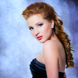 Beautiful glamour red-haired woman with bright make-up Royalty Free Stock Image