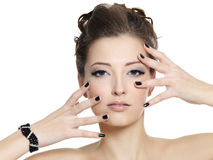 Beautiful glamour woman with black nails Stock Images
