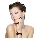 Beautiful glamour woman with black nails. Beautiful glamour young woman with black nails and stylish hairstyle posing on white background Stock Image