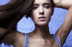 Beautiful glamour woman posing in blue Stock Images