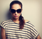 Beautiful glamour woman posing in fashion sunglasses. Vintage cl. Beautiful glamour model posing in fashion sunglasses. Vintage closeup portrait Stock Photo