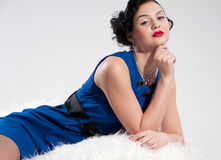 Beautiful glamour woman on white fur Stock Photography