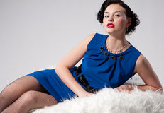 Beautiful glamour woman on white fur Royalty Free Stock Photography