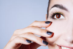 Beautiful glamour young woman with black nails and gold eyeshado Stock Photography