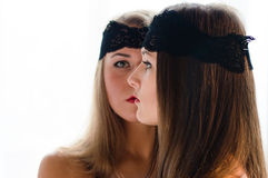 2 beautiful glamour young women with black bands on the face closeup portrait. Closeup portrait on two beautiful glamour young women with black bands on the face Royalty Free Stock Image