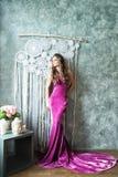 Beautiful Glamourus Fashion Model Woman. In Velvel Purple Dress stock image