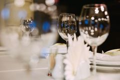 Beautiful glare in glass. Goblets on a banquet table Stock Image