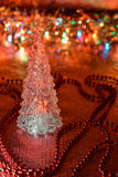 Beautiful glass Christmas tree on a background of lights Stock Image
