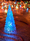 Beautiful glass Christmas tree on a background of lights Royalty Free Stock Images