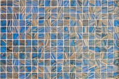 Beautiful glass mosaic for repair of elements with blue and yellow stripes stock photos