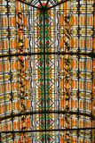 Beautiful glass mosaics in cathedral window. Orange figures created with glass stock photos