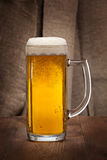 Beautiful glass mug of beer on the table Royalty Free Stock Photography
