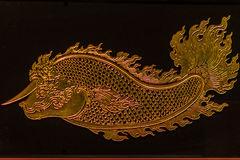 Beautiful glass ornament with gold filigree of golden fish with Royalty Free Stock Photos