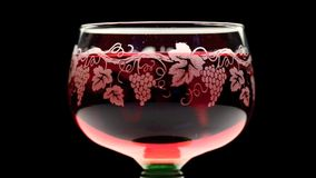 Beautiful glass of pink wine turning stock video