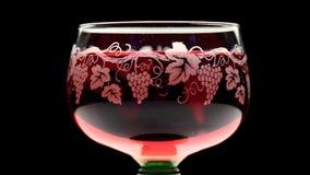 Beautiful glass of pink wine turning stock video