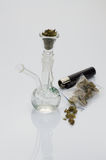 Beautiful glass pipe with marijuana. On white background, with lighter stock photo