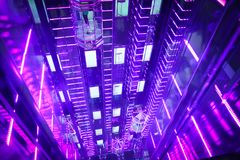 Beautiful glass purple elevators in the shopping center of Moscow Stock Images