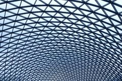 A beautiful glass roof in the building. A beautiful glass roof in the building is tinted in blue tones Stock Image