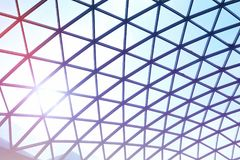 A beautiful glass roof in the building. A beautiful glass roof in the building is tinted in blue tones Stock Photo