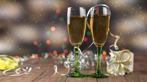 Beautiful glasses with champagne for the new year. With serpentine and gift gold packing on a wooden background with a bokeh Stock Image