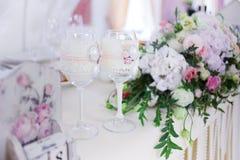 Beautiful glasses of champagne and wine, wedding decor, celebration, close-up. Beautiful glasses of champagne and wine, wedding decor, celebration Royalty Free Stock Image