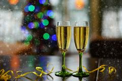 Beautiful glasses of two with a drink of champagne bubbles stock photography