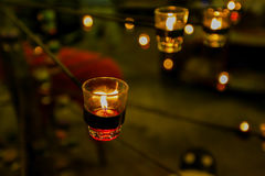 Beautiful glassy candle holders on stand Royalty Free Stock Images