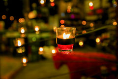 Beautiful glassy candle holders on stand Stock Images