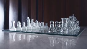 Beautiful glassy chessboard and all chessman Royalty Free Stock Photo