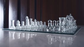 Beautiful glassy chessboard and all chessman Royalty Free Stock Image