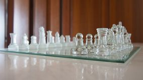Beautiful glassy chessboard and all chessman Royalty Free Stock Images