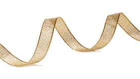 Beautiful glitter gold ribbon tape curl isolated. On white background stock images
