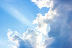 Beautiful gloomy blue sky with fluffy clouds in summer morning peace day as a background. Gray, white and turquoise color blured skyline photography stock photography