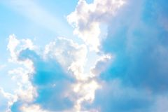 Beautiful gloomy blue sky with fluffy clouds in summer morning peace day as a background. Gray, white and turquoise color blured skyline photography stock image