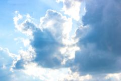 Beautiful gloomy blue sky with fluffy clouds in summer morning peace day as a background stock images