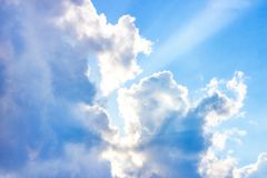 Beautiful gloomy blue sky with fluffy clouds in summer morning peace day as a background stock image
