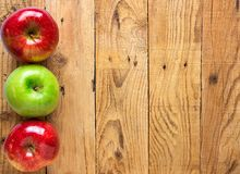Beautiful Glossy Red Green Apples on Aged Plank Barn Wood Background. Autumn Fall Harvest Thanksgiving Concept. Rustic Vintage Royalty Free Stock Photo