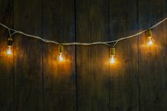 Glowing light bulbs on autumn wooden background. royalty free stock photos