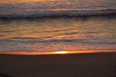 Glowing ocean at sunrise at Virginia Beach royalty free stock photography