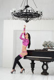 Beautiful go-go dancer in a pink suit and high heels Royalty Free Stock Image