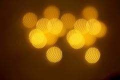 A beautiful gold bokeh with pattern of geometric elements on a dark background Royalty Free Stock Photography