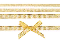 Gold bow and gold ribbons. Beautiful gold bow and gold ribbons isolated on white background Stock Image