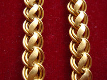 Beautiful gold chain on red surface. Picture of beautiful gold chain on red surface Stock Images